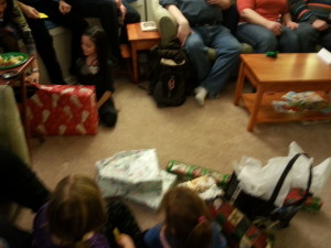 Children gathered, presents gathered, time for the gift exchange.