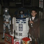 "R2 guards the ""Toys for Tots"" donations"