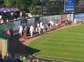 Pre-game costumed kids parade.