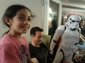 Dan enjoys his new stormtrooper while Maeve looks on