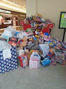 The toys are added to the toy drive pile.