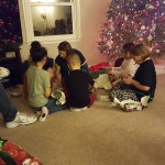 The kids open their gifts.
